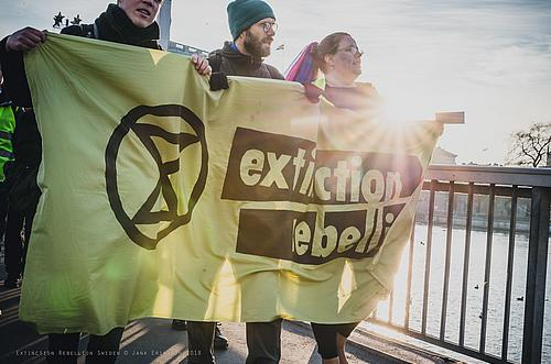 Demonstranten mit einem Extinction Rebellion-Banner Ende 2018 in Stockholm.